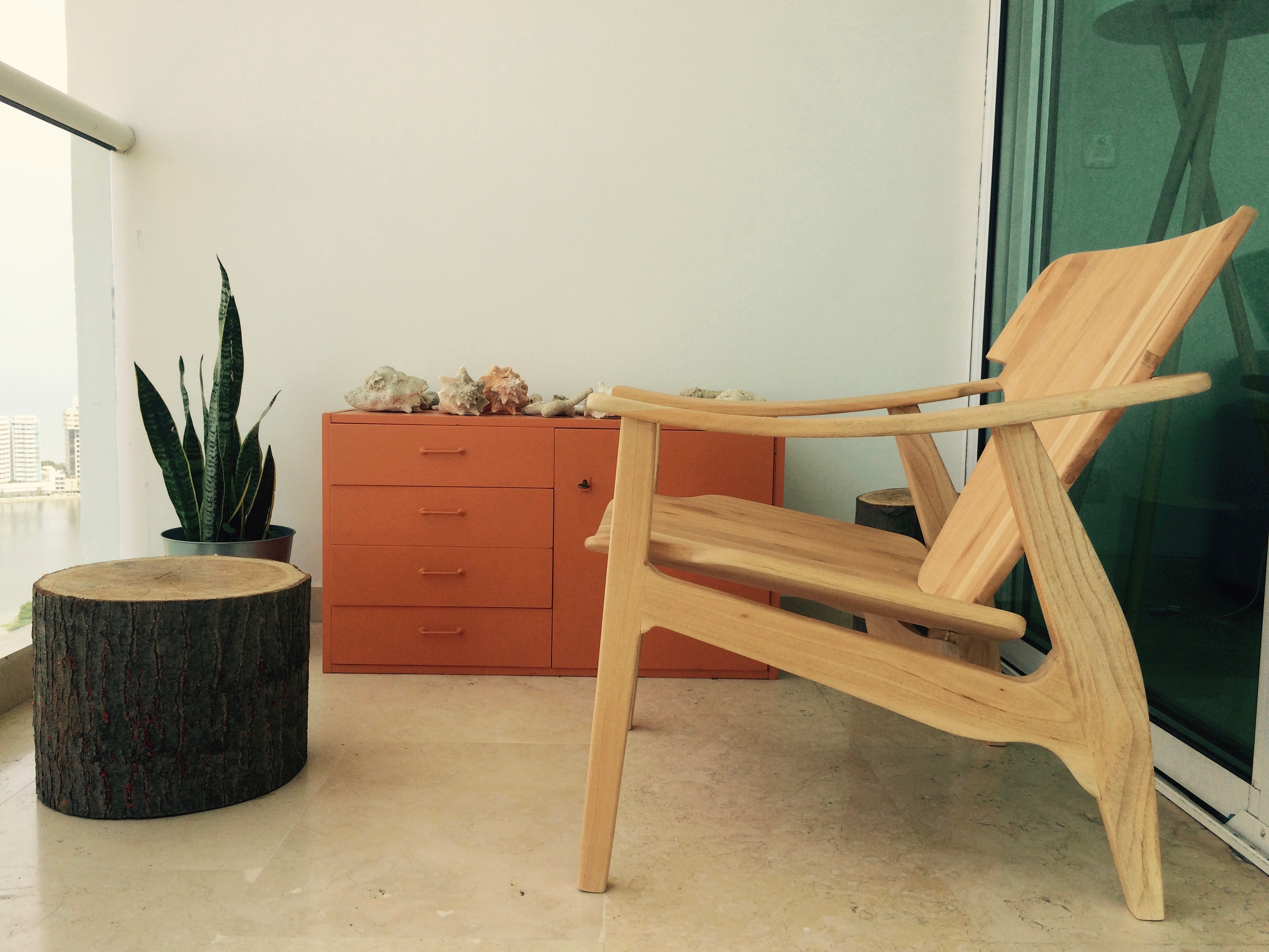 Wooden – relax on the balcony – chairs – Pelican Stories
